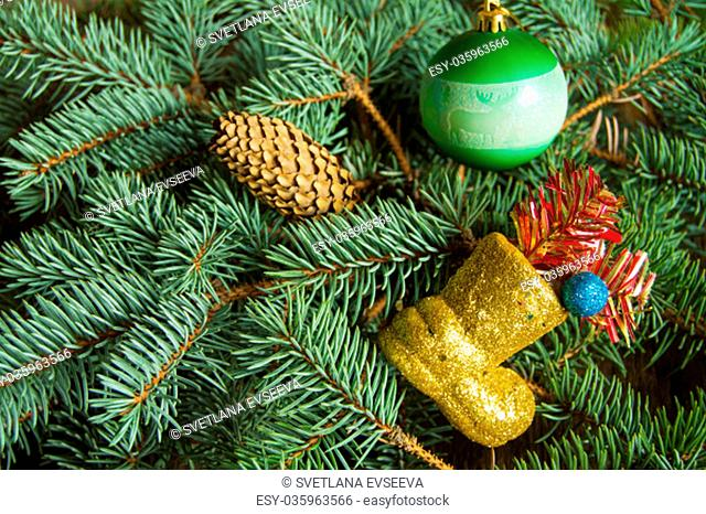 Christmas background, boots with gifts, Christmas balls on fir branches