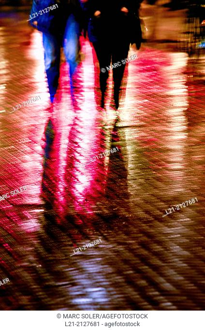 Legs at rainy night. Barcelona, Catalonia, Spain