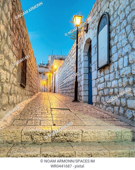 Old Stone Alleyway With Electric Lights