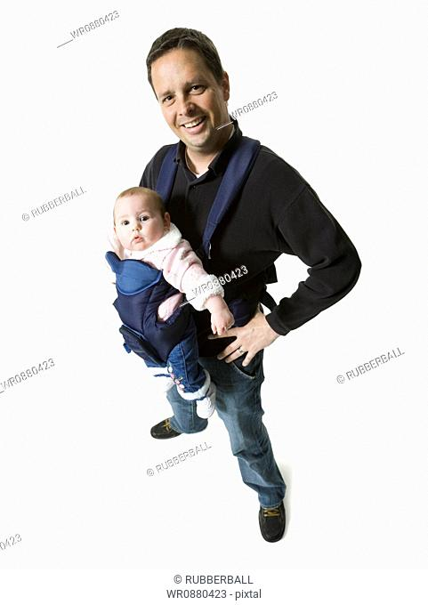 Portrait of a man carrying his daughter