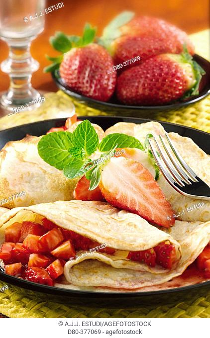 Strawberries with kirsch pancakes