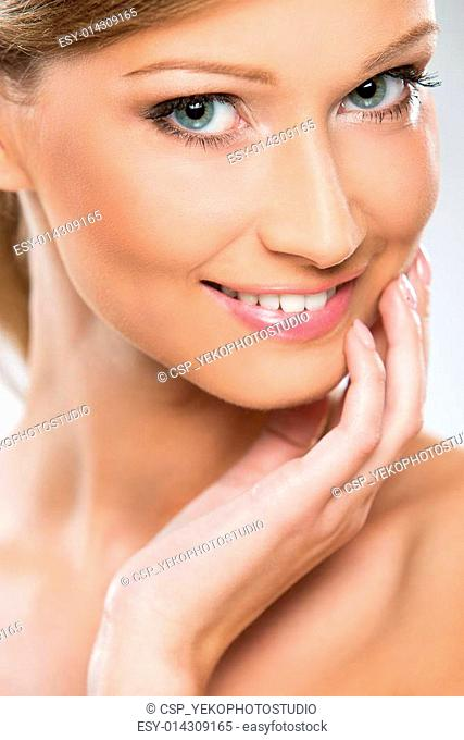 Natural looking woman enjoying her beauty