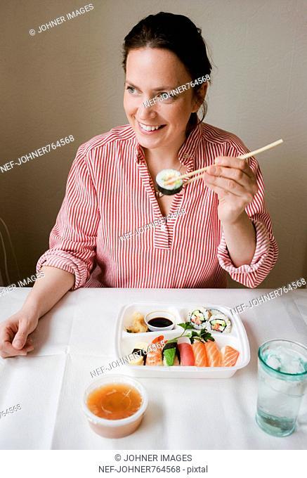 One woman having sushi, Sweden