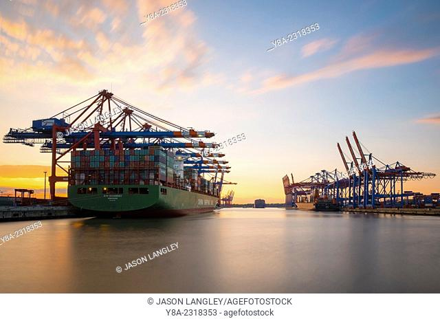 Cargo ships being loaded at Eurokai and Burchardkai in Hamburg Harbor at sunset, Waltershofer Hafen, Hamburg, Germany