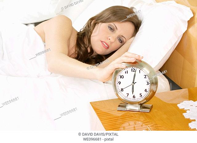 Beautiful Caucasian woman waking up in the morning