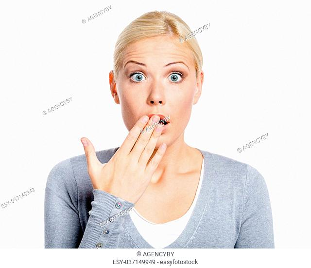 Shocked girl covers her opened mouth with hand, isolated on white