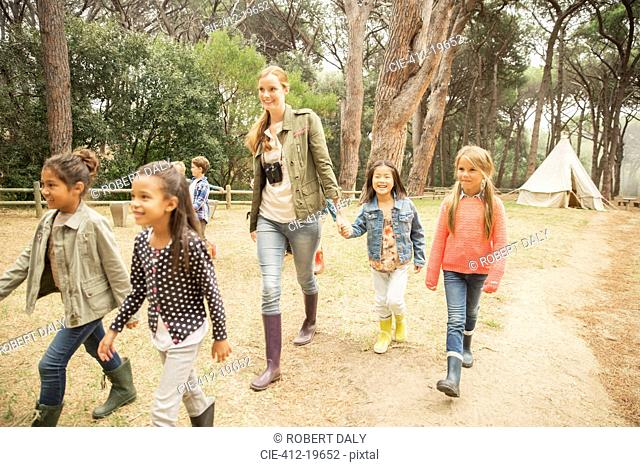 Students and teacher walking on dirt path