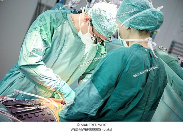 Heart surgeon during a heart operation