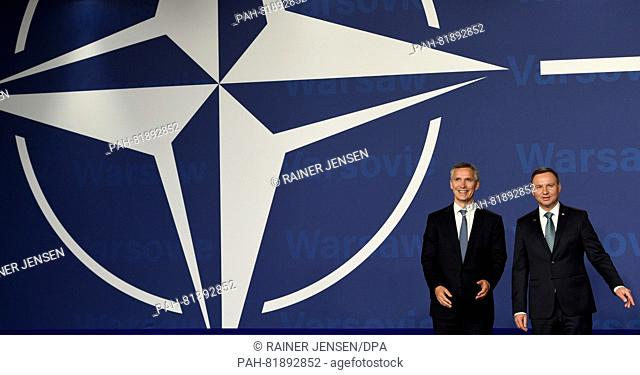 Nato General Secretary Jens Stoltenberg (l)and Polish President Andrzej Duda standing together before the official welcoming ceremony at the national stadium...