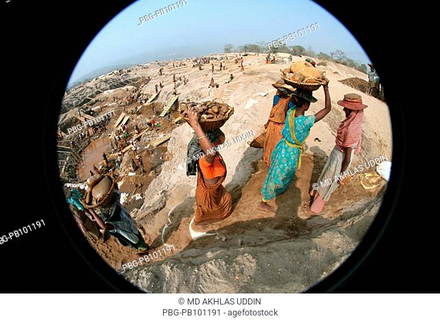 At least 9,000 people including 3000 women and 1000 children work as stone laborer, on the bank of the Dholai river, in Bholaganj