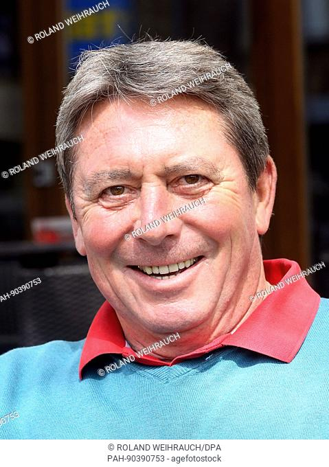 Bernd Krauss, former coach of German Bundesliga soccer club Borussia Moenchengladbach, smiles as he sits in front of a café in Moenchengladbach,Germany