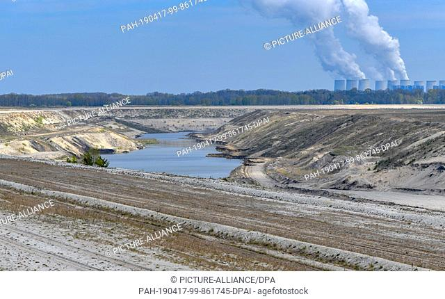 17 April 2019, Brandenburg, Cottbus: Panoramic view over the former opencast lignite mine Cottbus-Nord. The entire land mass is to be covered later once by...