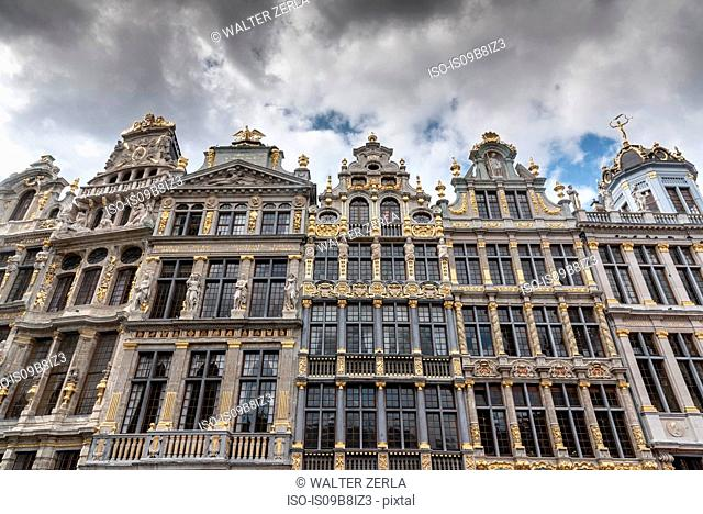 Low angle view of historic town house facades at Grand Central, Brussels, Belgium
