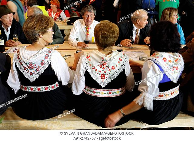 Switzerland, Valais, Val d'Herens, village of Evolene at fall, CIME festival where are performed many folkloric activities