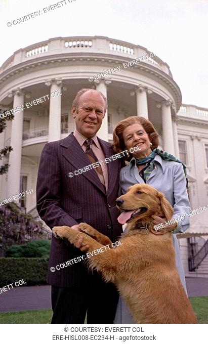 President Gerald Ford and wife Betty pose with Liberty, their pet golden retriever. South Lawn of the White House. May 9, 1975