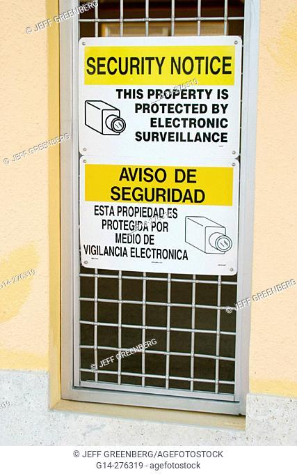Bilingual sign warning of surveillance. Miami Beach. Florida. USA