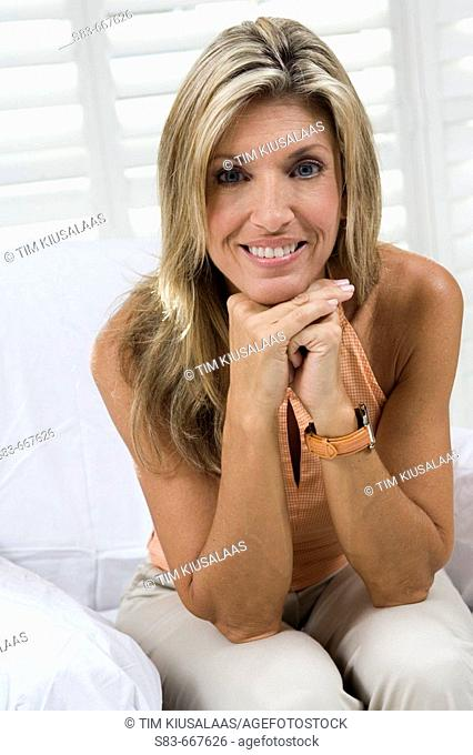 Portrait of woman sitting on chair