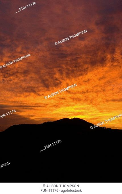 A dramatic sunrise sets the sky alight with vibrant colour over the Daintree Rainforest, North Queensland, Australia