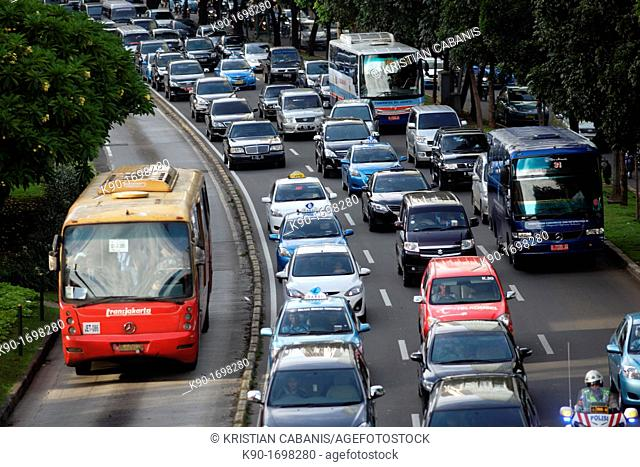Heavy traffic seen from above on Jalan Sudirman with separated bus lane, Central Business District of Jakarta, Indonesia, Southeast Asia
