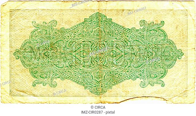intricate design on the back of a bank note