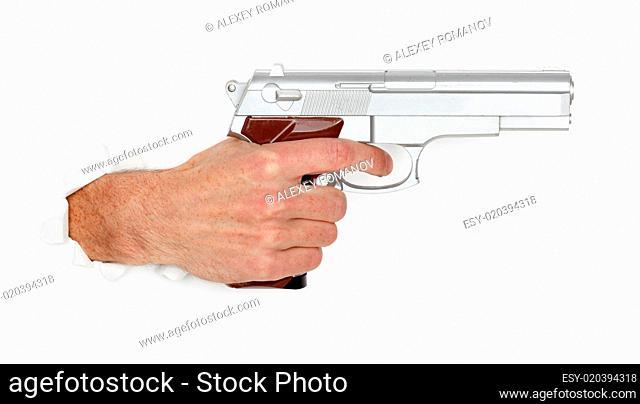 Man&#039 s hand holding a large silver handgun