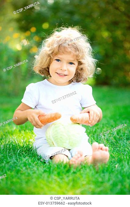 Child playing with vegetables