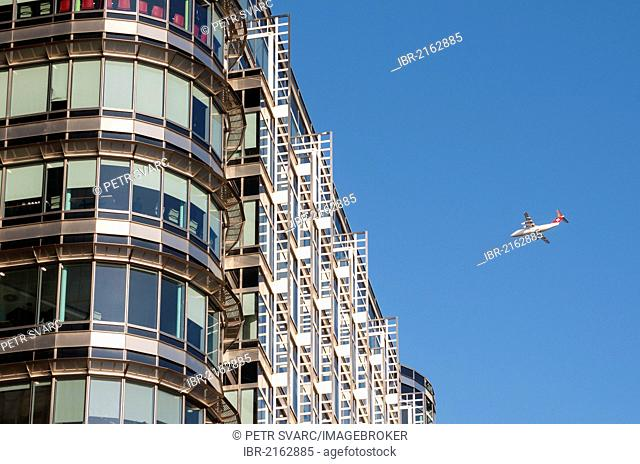 British Aerospace Avro RJ100 Airliner and office building at 20 Canada Square, designed by Adrian D. Smith of Skidmore, Owings and Merrill architects