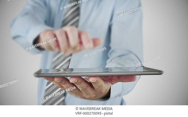 Businessman using tablet to view hologram