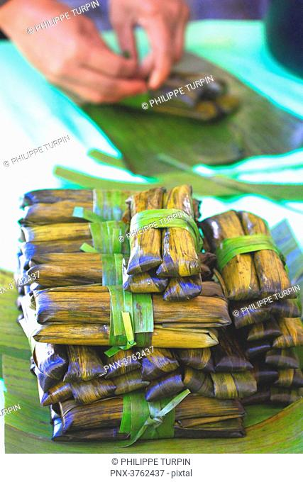 Philipins, Cebu City. Cebu Island. Suman is a rice cake originating from the Philippines. It is made from glutinous rice cooked in coconut milk