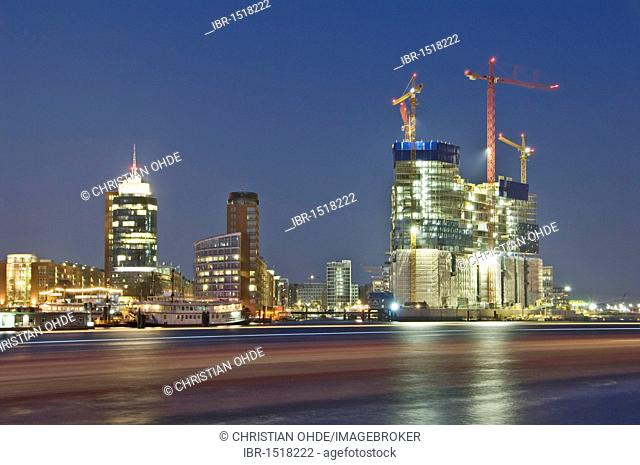 The Elbphilharmonie philharmonic hall under construction in the Hafencity harbour city district of Hamburg, Germany, Europe