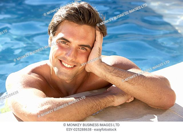 Young Man Relaxing In Swimming Pool