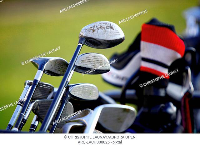Golf clubs on a green in France