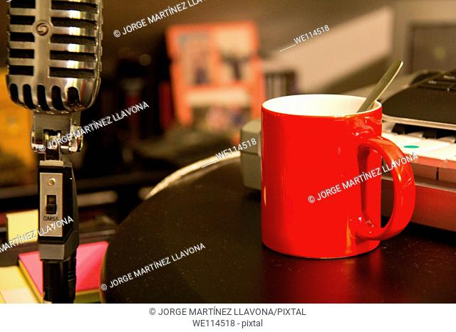 Cup and Microphone in a studio