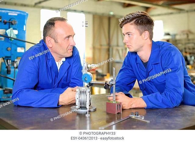 Senior and junior engineers in discussion