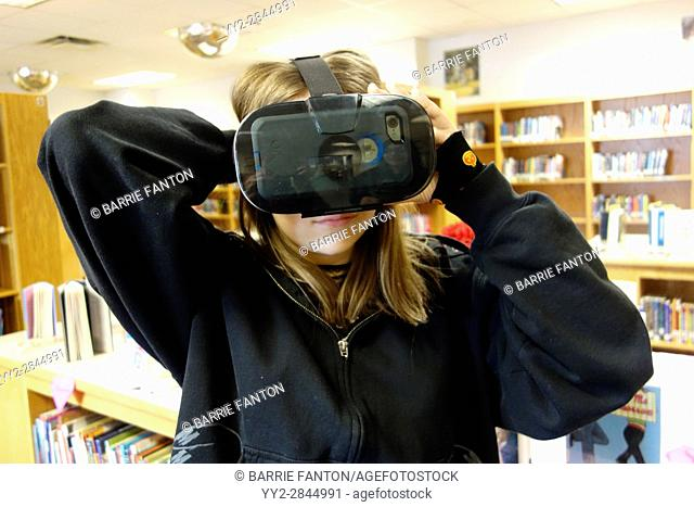 7th Grade Girl Wearing Virtual Reality Glasses, Wellsville, New York, USA