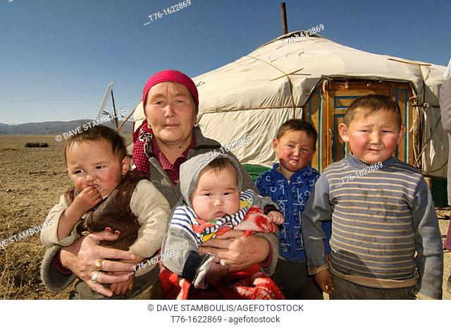Kazakh eagle hunter's family in front of their ger yurt in the Altai Region of Bayan-Ölgii in Western Mongolia