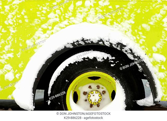 Detail of emergency vehicle crusted with windblown snow