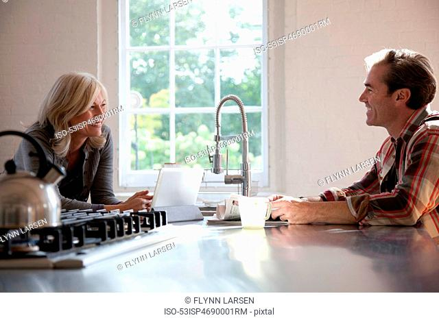 Older couple relaxing in kitchen