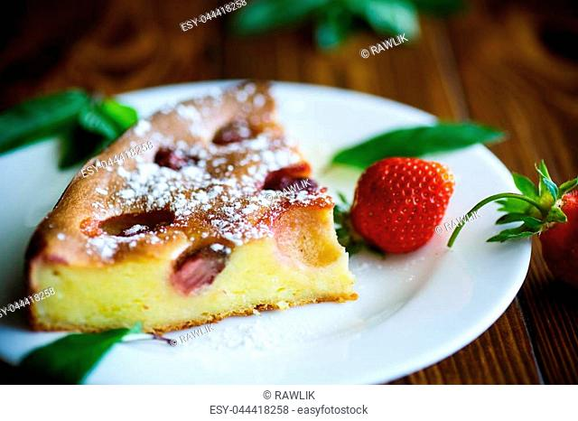 cottage cheese sweet casserole with strawberries on a wooden table