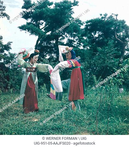 A performance of a traditional Korean mask dance, Songpa Sandae Noli. North Korea Culture, 1962