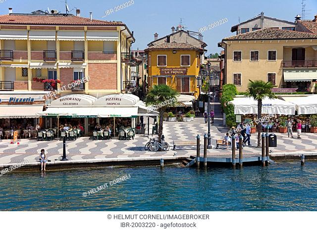 Boardwalk with lakeside restaurants, Lazise, Lake Garda, Verona province, Veneto, Italy, Europe