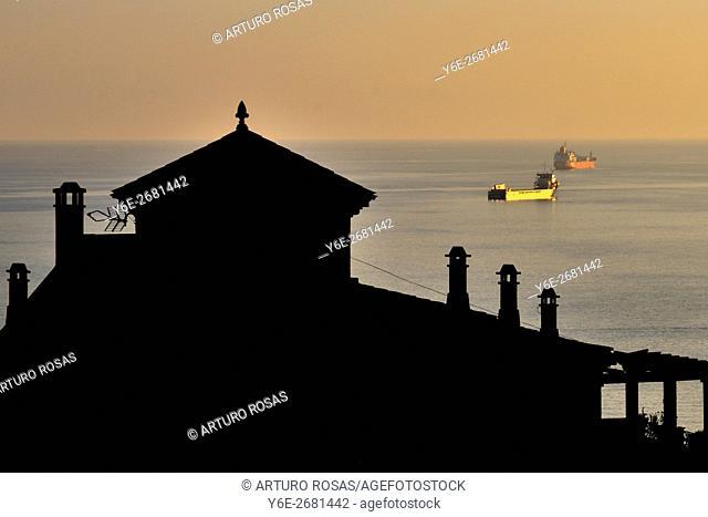 Boats in the sea behind a house in Tarragona (Catalonia), Spain