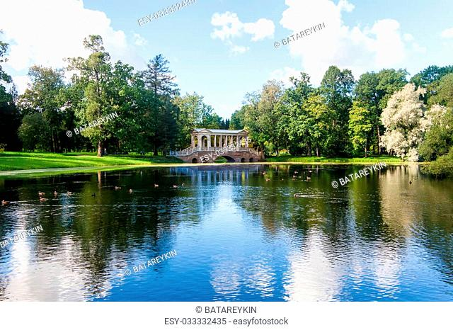 The Marble Bridge in Royal Catherine park located in Pushkin, Saint Petersburg. The building of Queen Catherine's Palace on sunny day