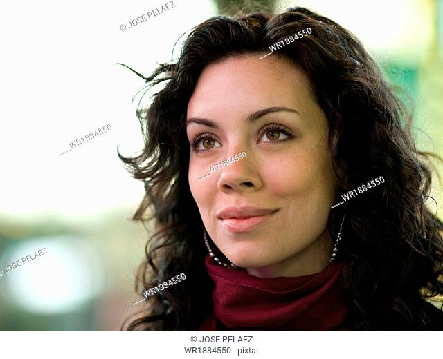 USA, New York City, Manhattan, Times Square, Portrait of mixed race woman