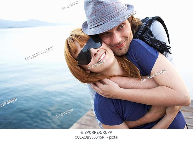 Man hugging girlfriend