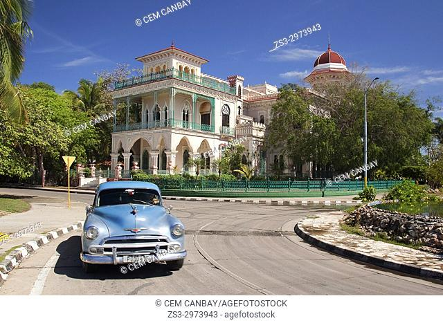 Old American car in front of the Palacio De Valle -Valle's Palace In Punta Gorda district, Cienfuegos, Cuba, West Indies, Central America