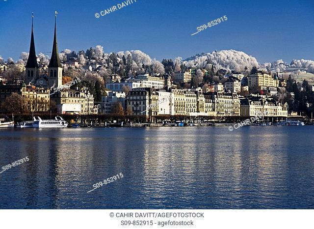 General view of the town of Lucerne Luzern in the Canton of Lucerne, Switzerland with the Reuss River in the foreground and the Hofkirche church in the...