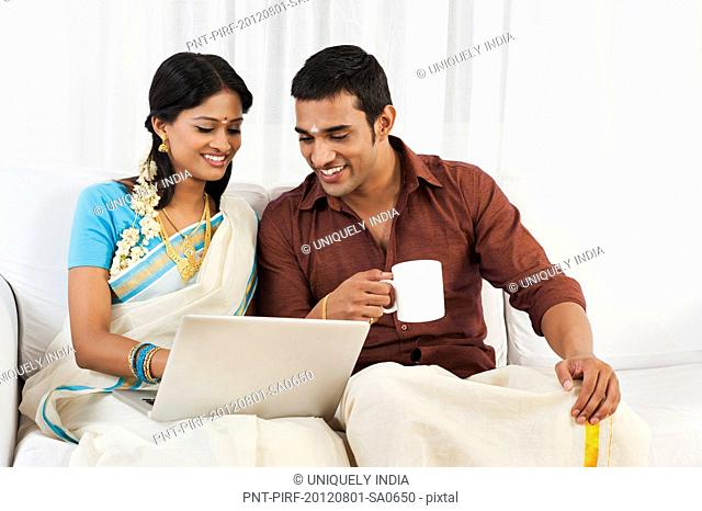 South Indian couple using a laptop