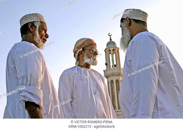Omani men in Al Suwaiq, Oman