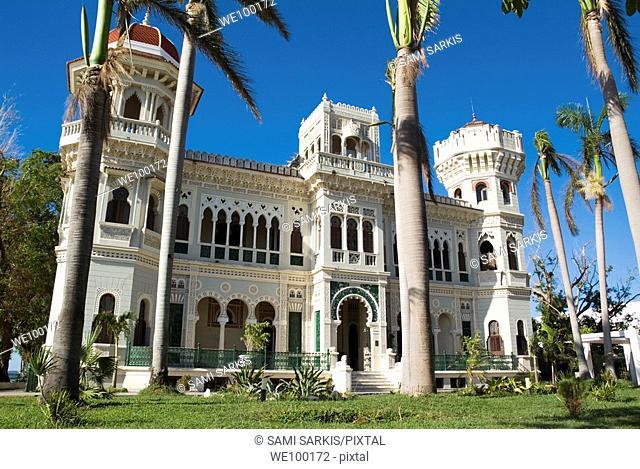 Palm trees in front of the Palacio de Valle on Punta Gorda, Cienfuegos, Cuba
